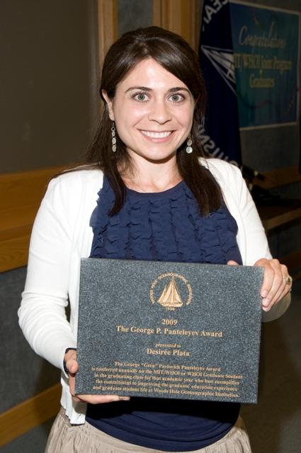 Desirée Plata showing her 2009 Panteleyev Award.