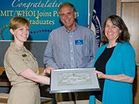 Lieutenant Commander Jennifer J. Landry receiving the Rear Admiral Richard F. Pittenger, USN (Ret) Award